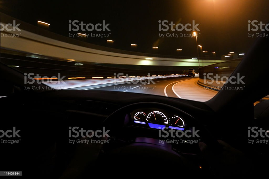 Driving fast at night royalty-free stock photo