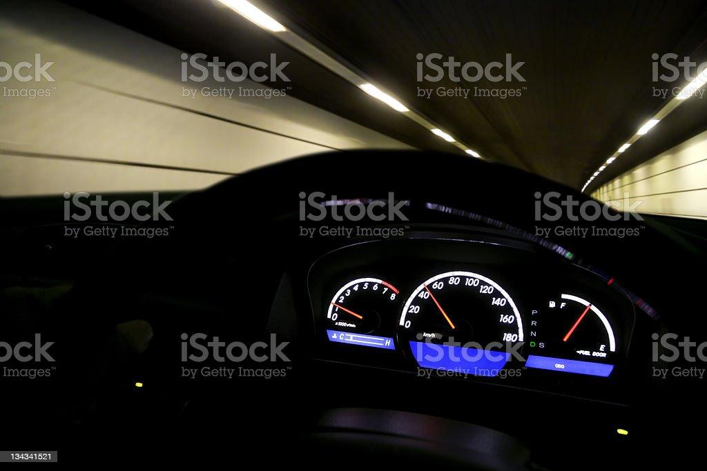 Driving fast at night royalty-free stock photo