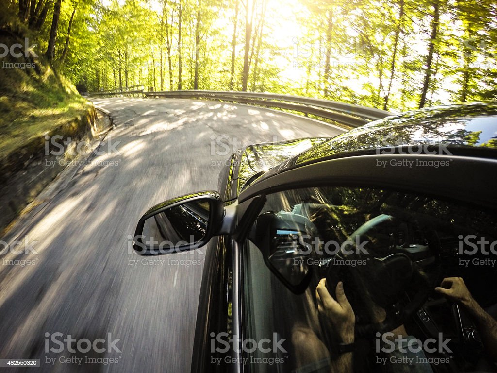 Driving fast on the forest stock photo