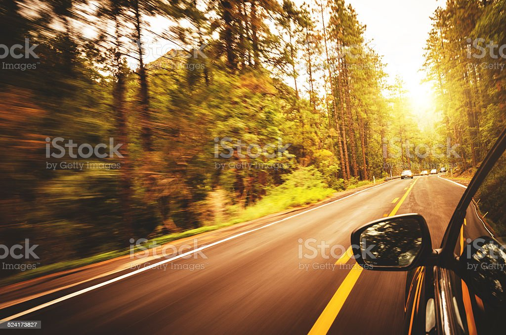 driving fast on the highway stock photo
