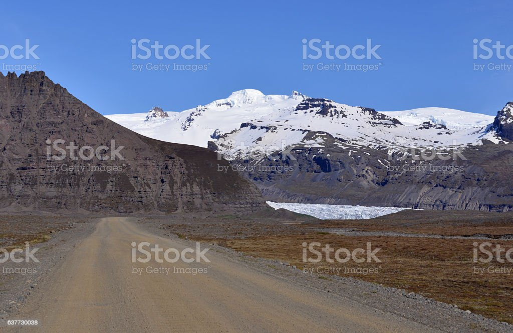 Driving gravel road in Iceland stock photo