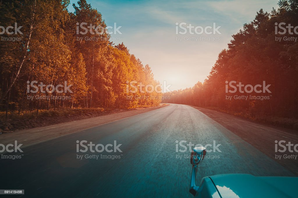 Driving in a car, on a road stock photo