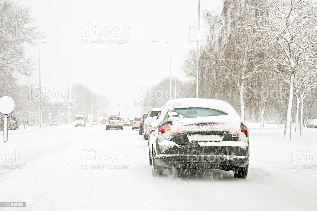 Driving in a snowstorm Amsterdam the Netherlands stock photo
