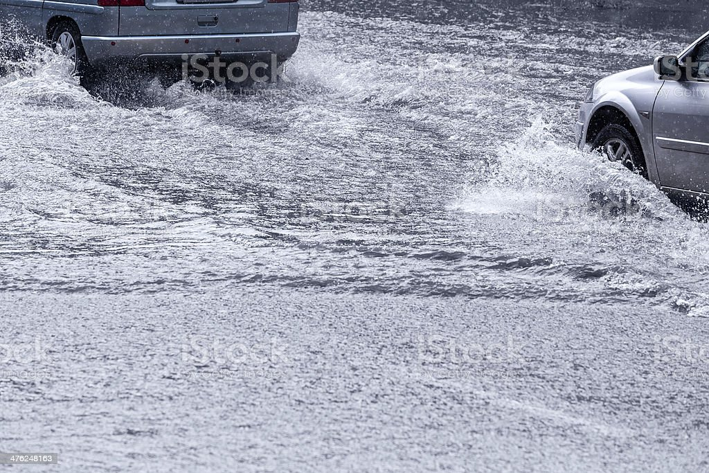Driving in flood water stock photo