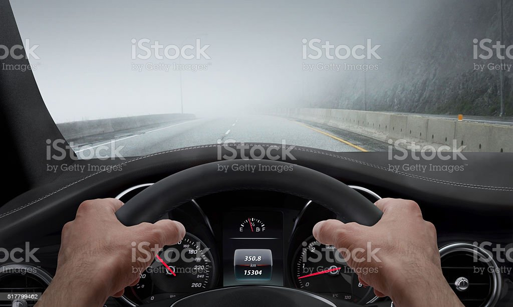 Driving in fog weather. View from the driver angle stock photo