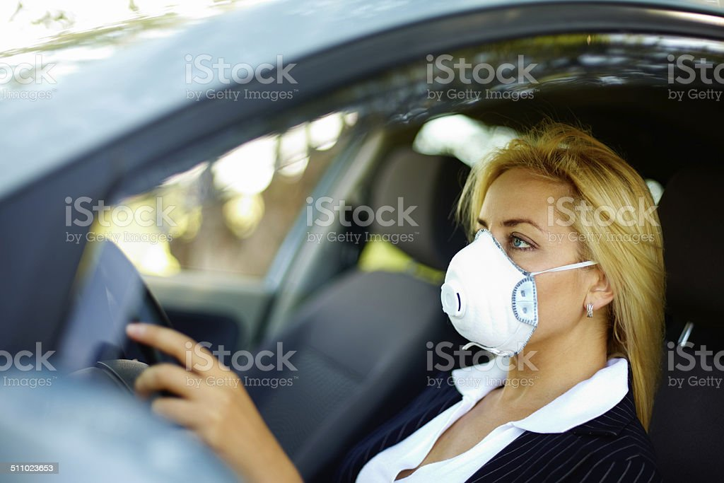 Driving in polluted zone stock photo