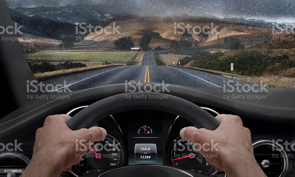 Driving in rainy weather. View from the driver angle stock photo