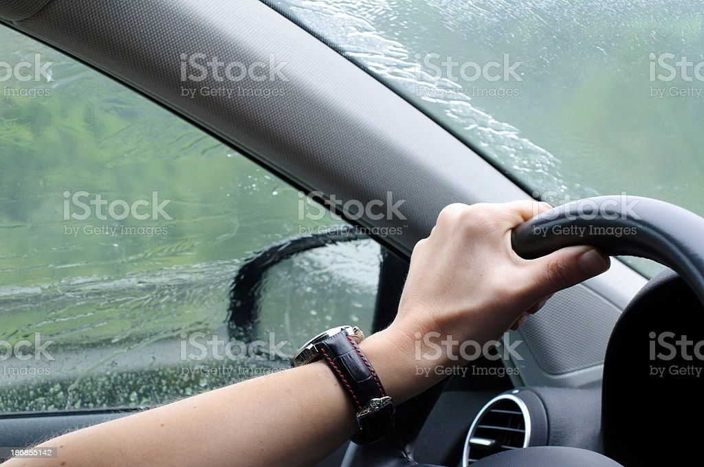 Driving in rainy weather with car stock photo