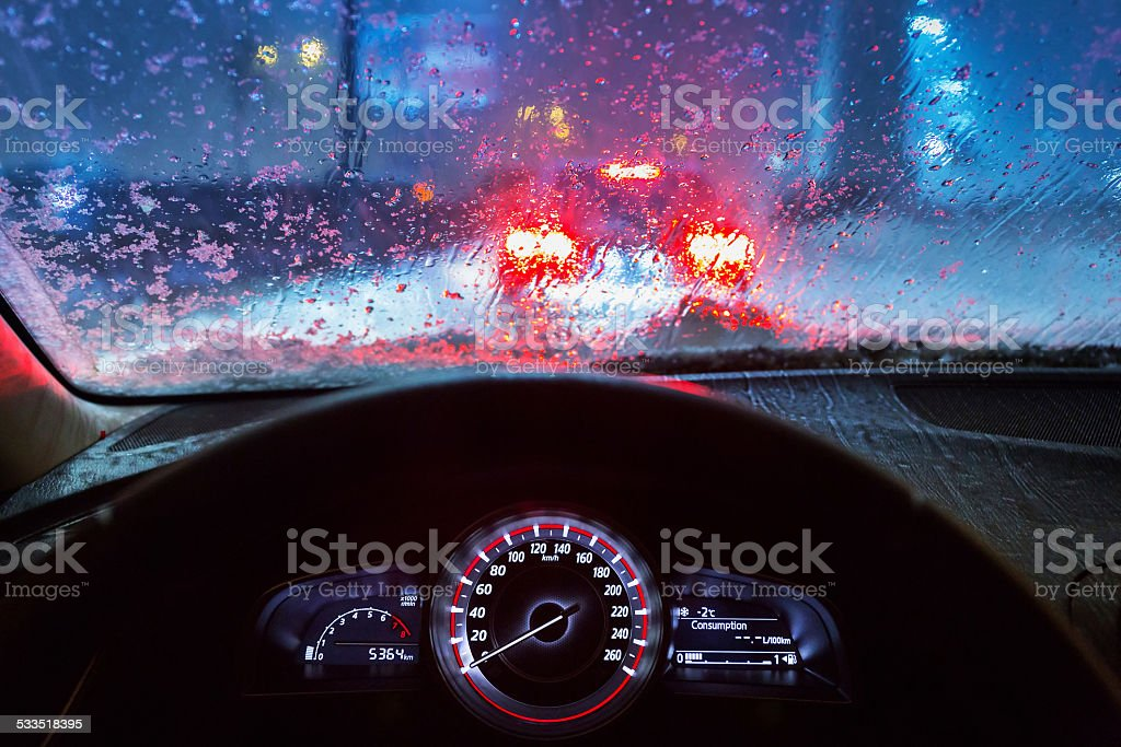 Driving in snowy winter stock photo