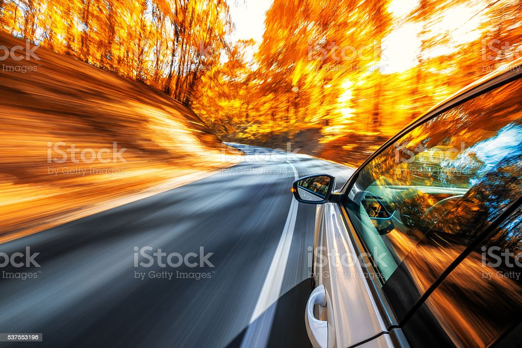 Driving in the fall stock photo