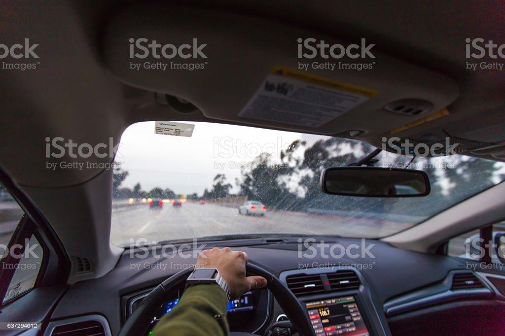Driving in the rain in winter stock photo