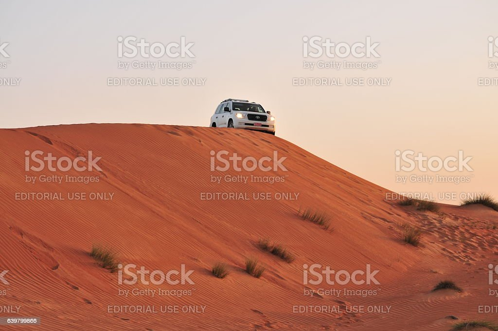 Driving in the sand stock photo