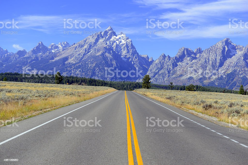Driving in the Teton Range, Rocky Mountains, Wyoming, USA stock photo