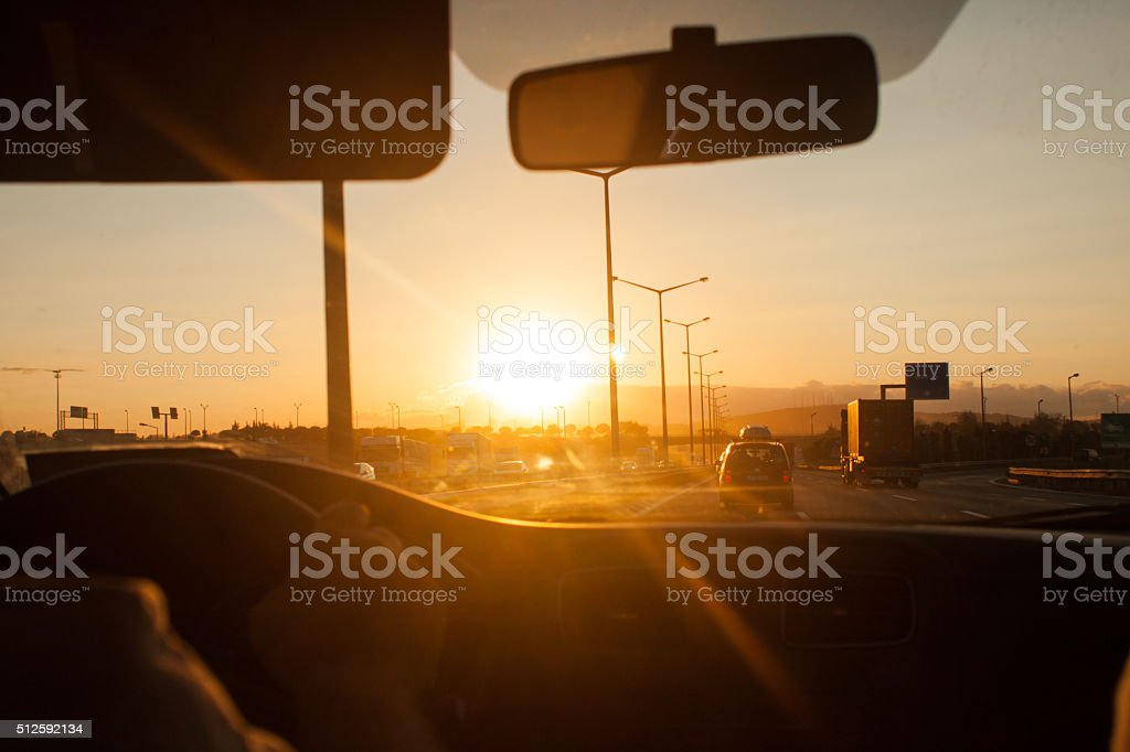 Driving in traffic inside car stock photo