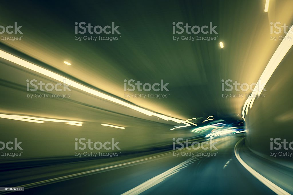 Driving in tunnel with long exposure light trails royalty-free stock photo
