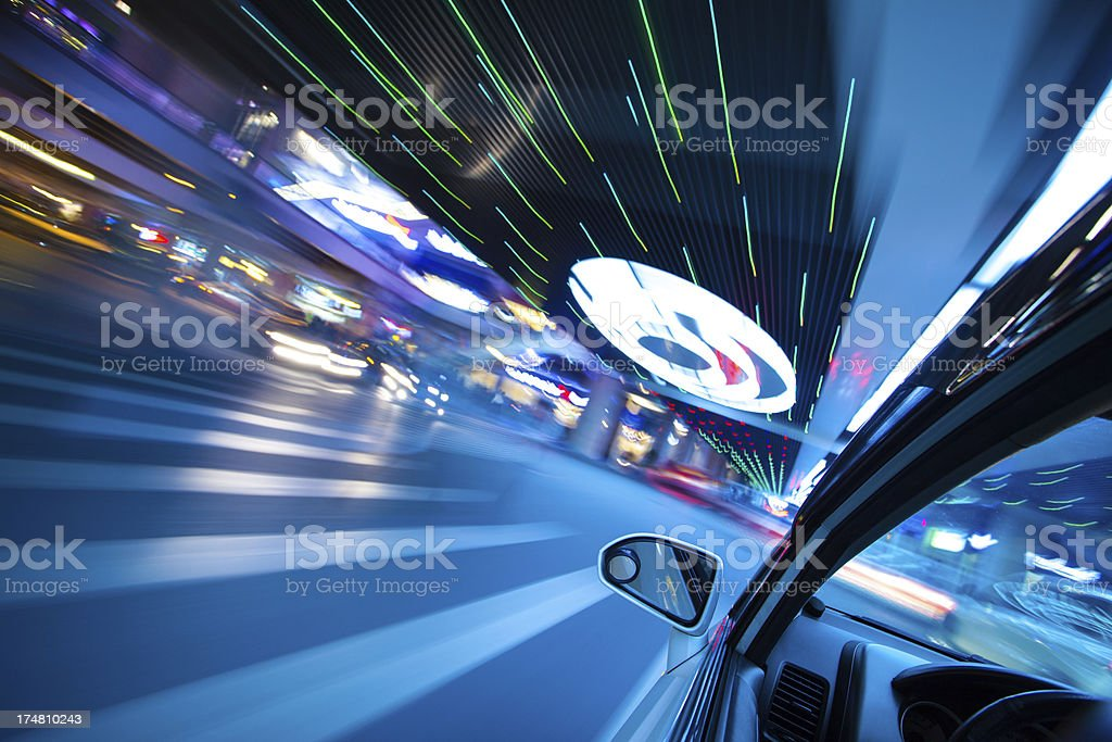Driving in urban scene at night royalty-free stock photo