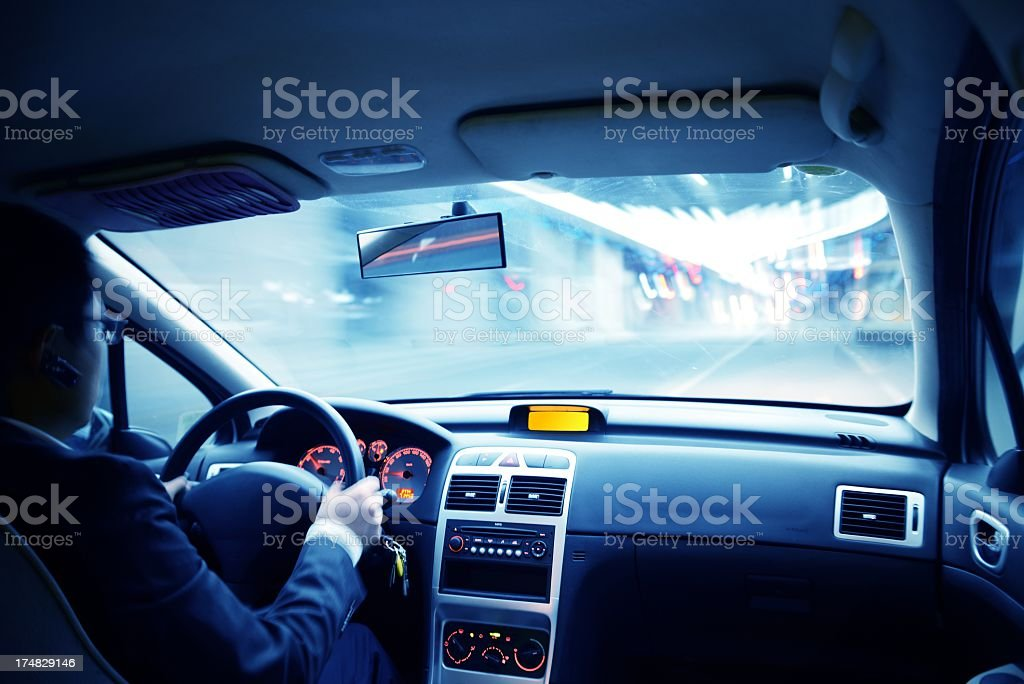 Driving in urban scene royalty-free stock photo