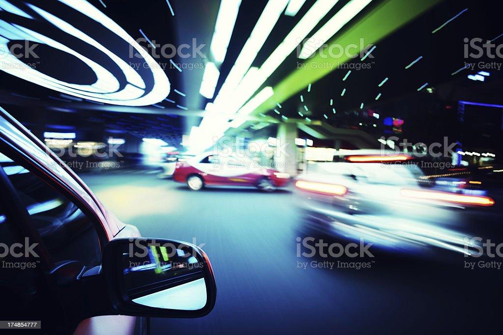 Driving in urban scene royalty-free stock photo