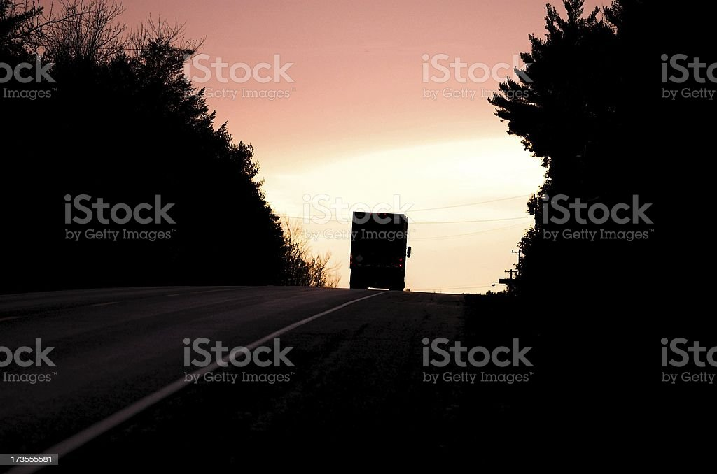 driving into sunset royalty-free stock photo