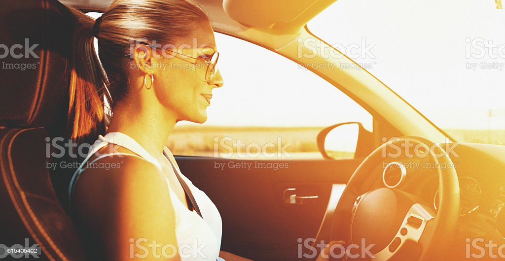 Driving into the sunset. stock photo