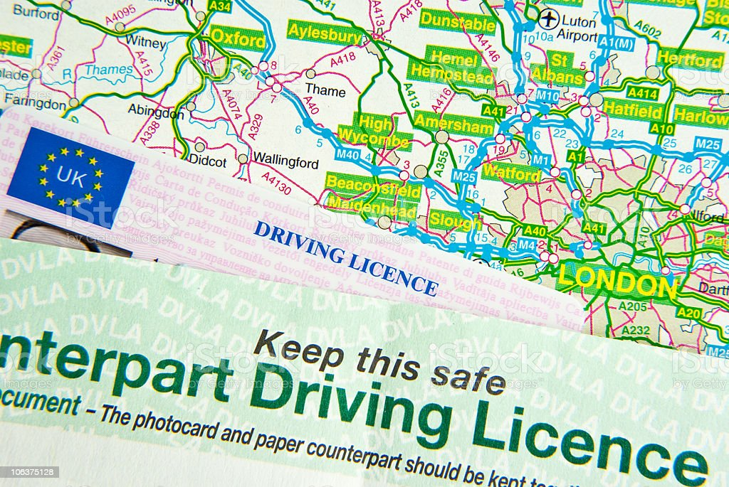 Driving Licence on Map stock photo