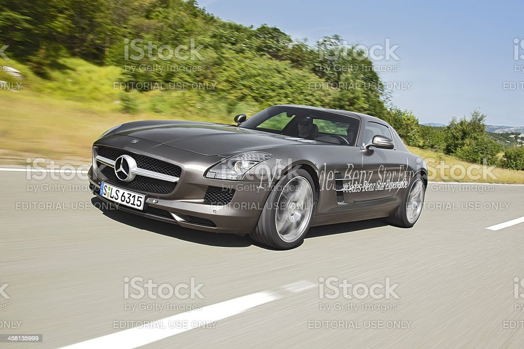 Driving Mercedes SLS AMG stock photo