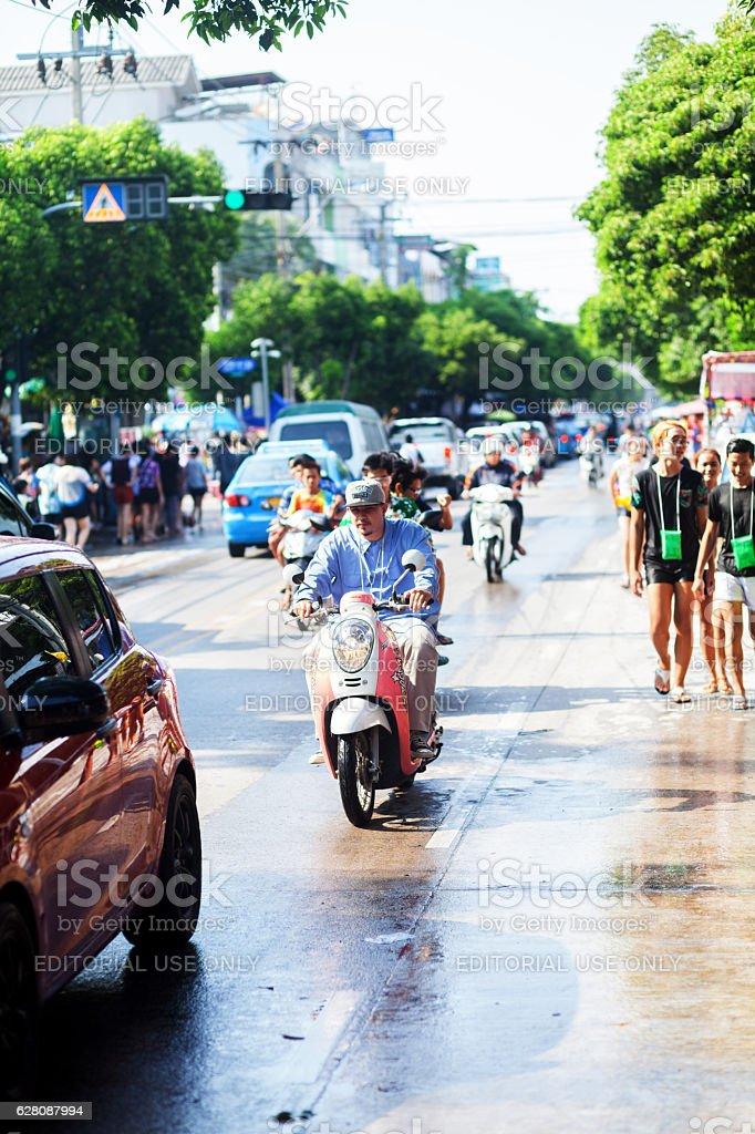 Driving motorcycle at Songkran day stock photo