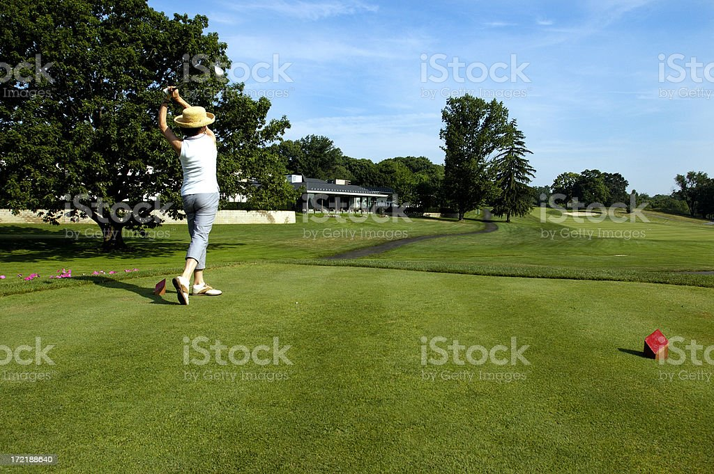 driving off the women's tee stock photo