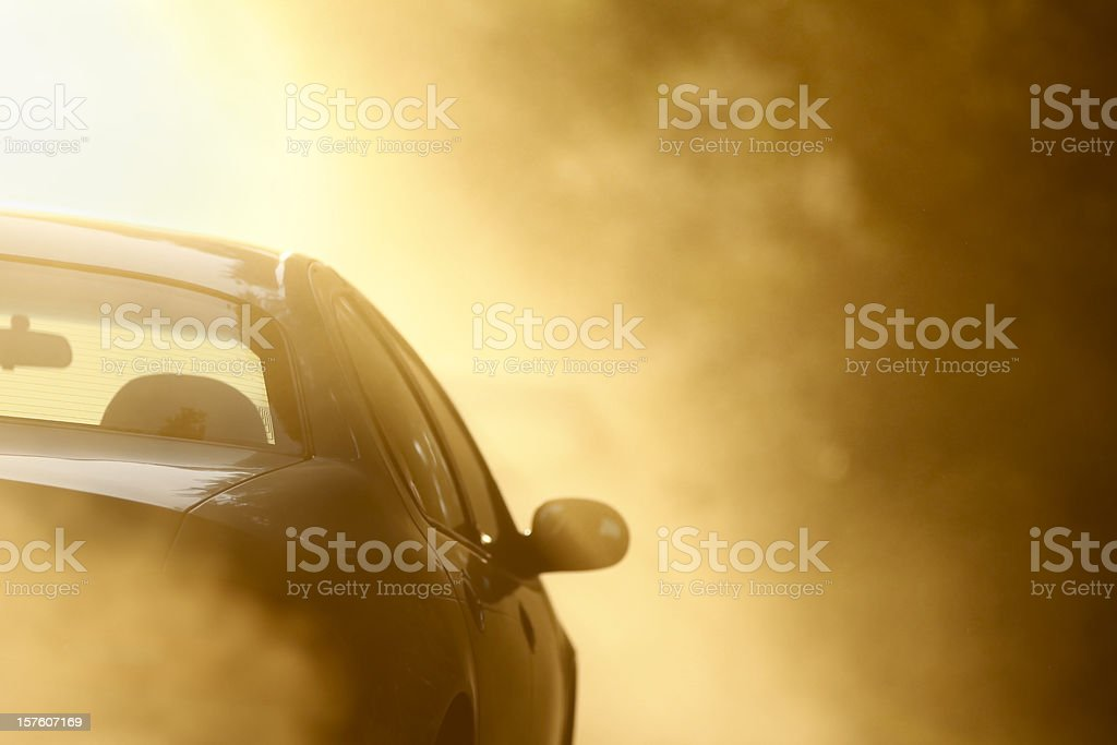 Driving on a Dusty Dirt Road stock photo