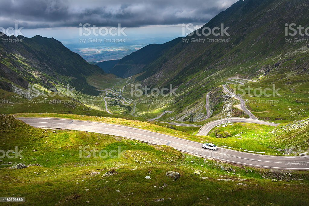 Driving on alpine highway at sunny day stock photo