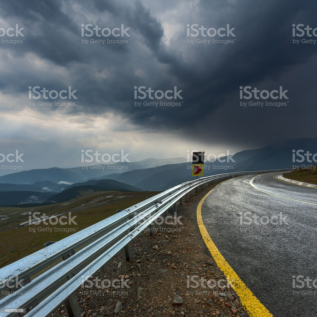 Driving on an empty asphalt road at stormy weather stock photo