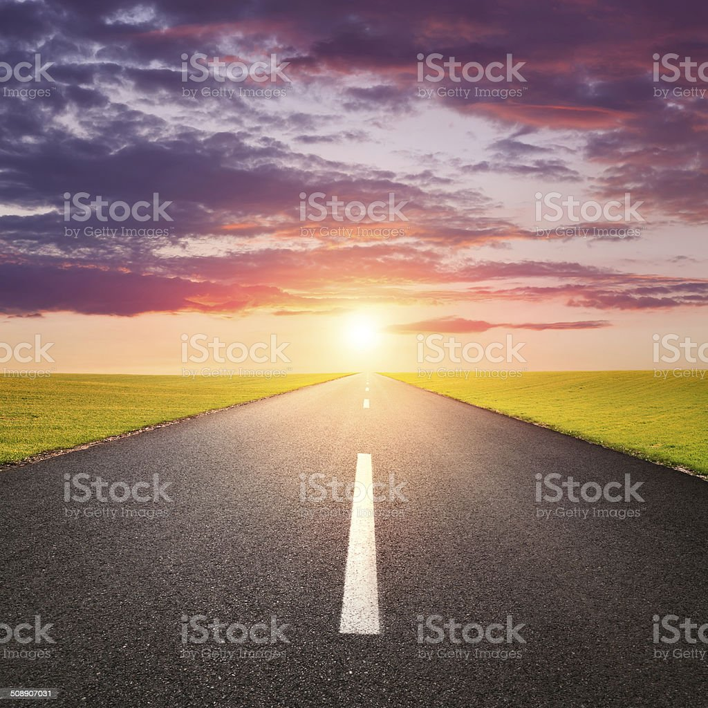 Driving on an empty road at sunsrise stock photo