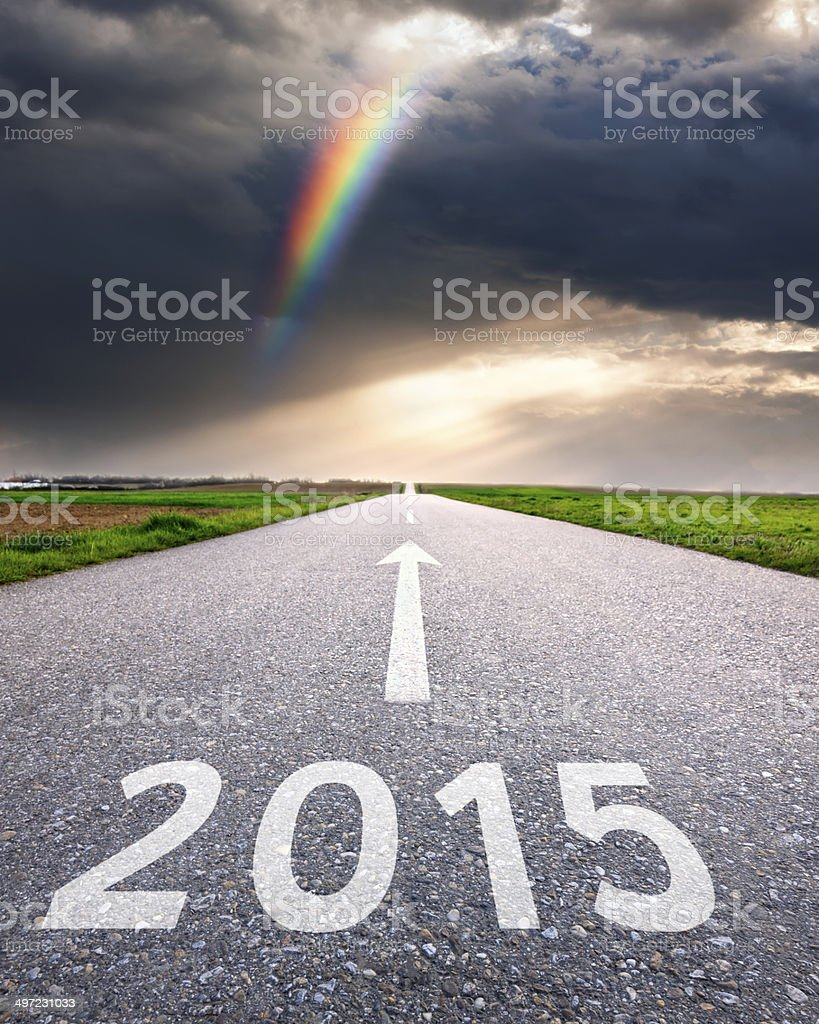 Driving on an empty road forward to the 2015 stock photo