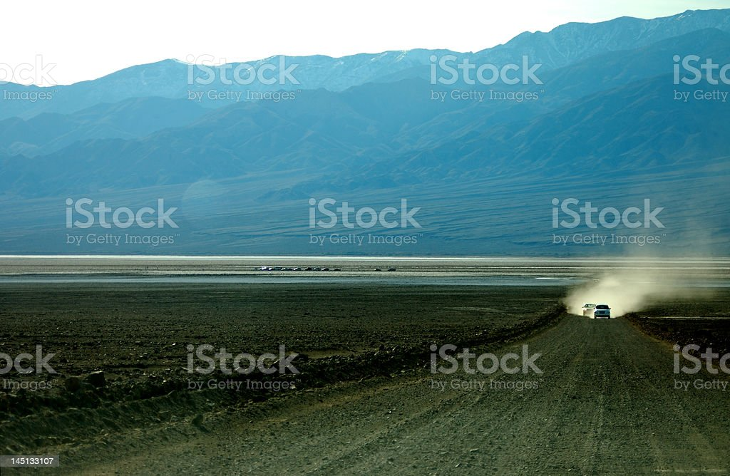 Driving on dirt road stock photo