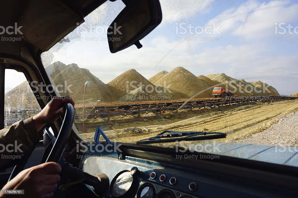 Driving on dirt road with off-road vehicle royalty-free stock photo