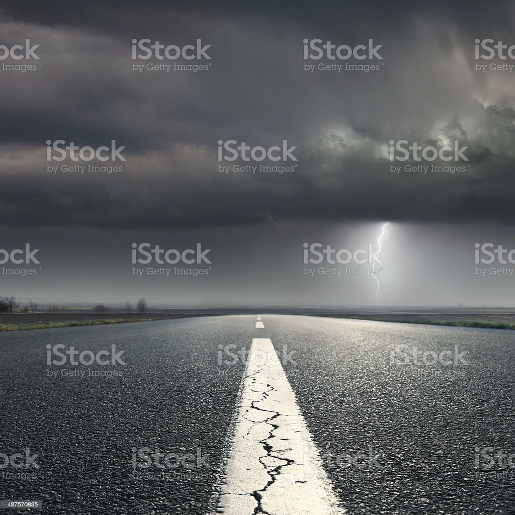 Driving on highway towards the storm stock photo