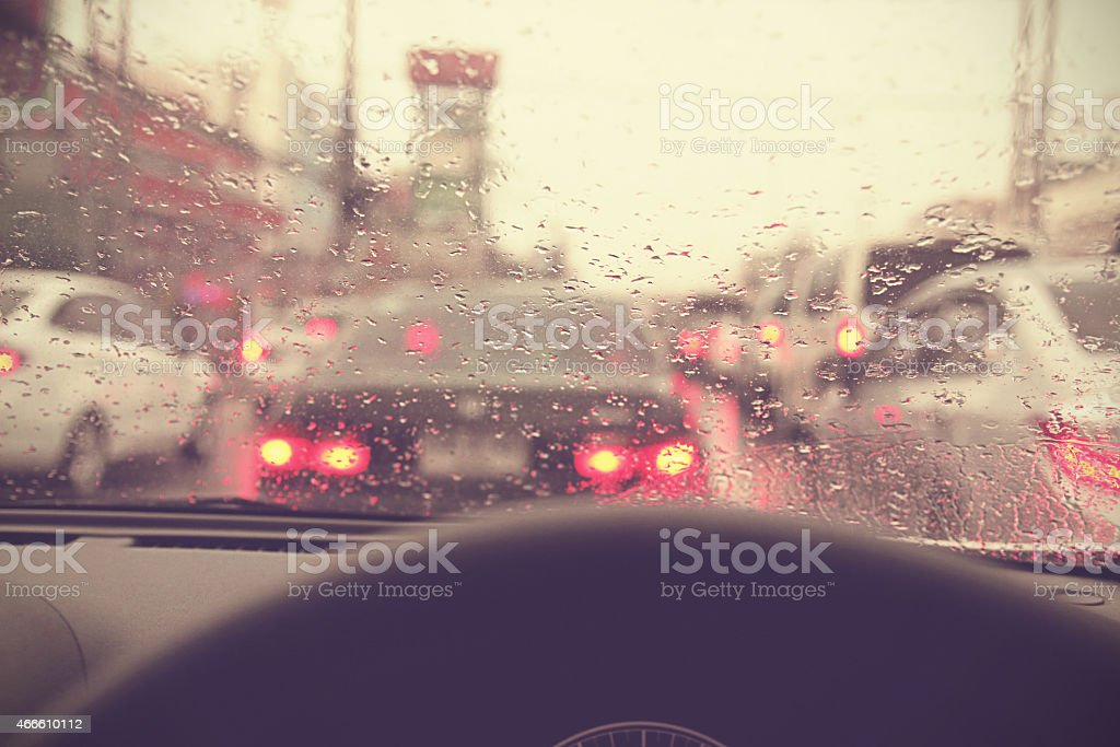 Driving on rainy in a city, view from inside stock photo