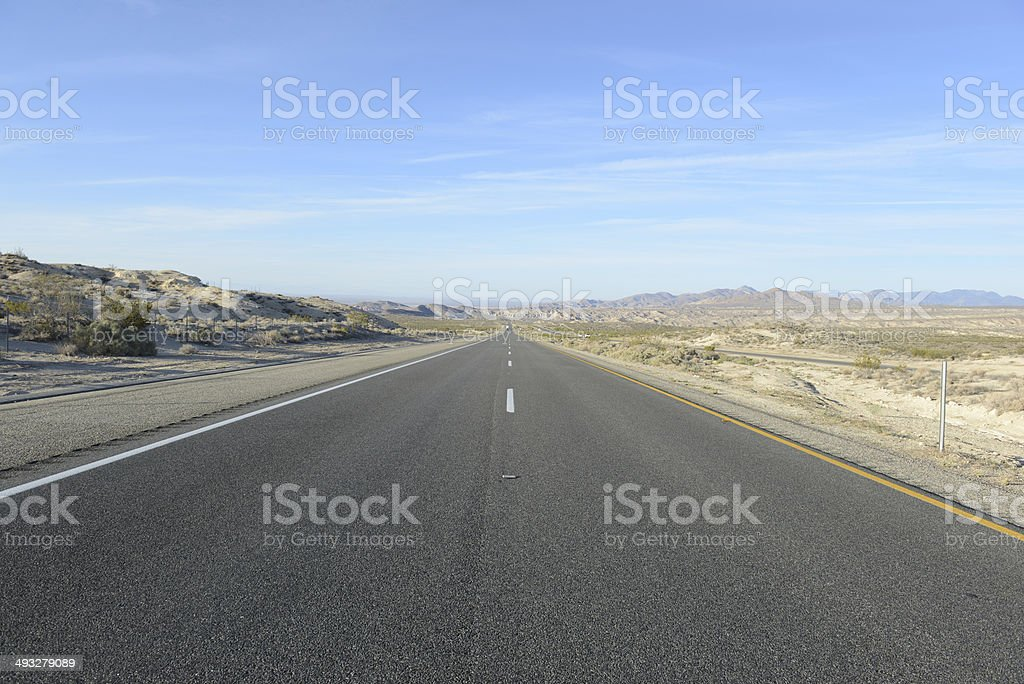 Driving on Remote Road in the Desert, Southwestern USA royalty-free stock photo