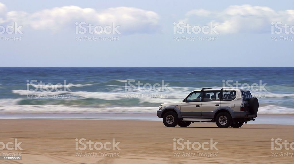 Driving on the beach stock photo