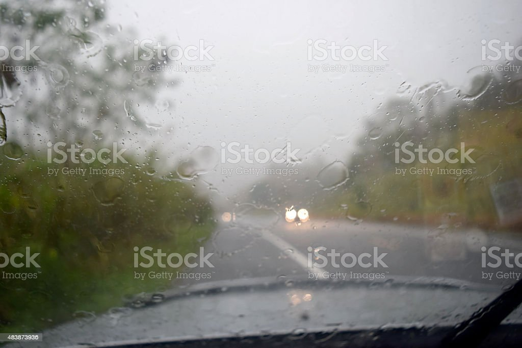 Driving on the road during the rain. stock photo