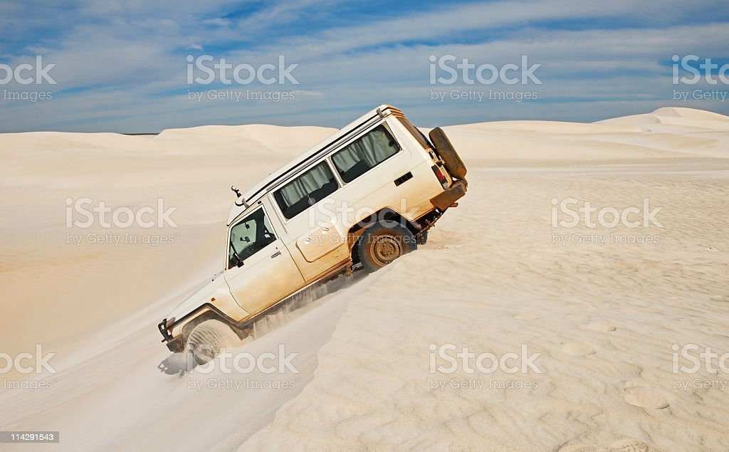Driving Over Sand Dunes royalty-free stock photo