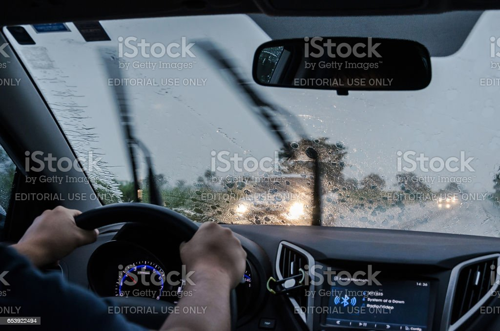 Driving the car on the road on a rainy day stock photo