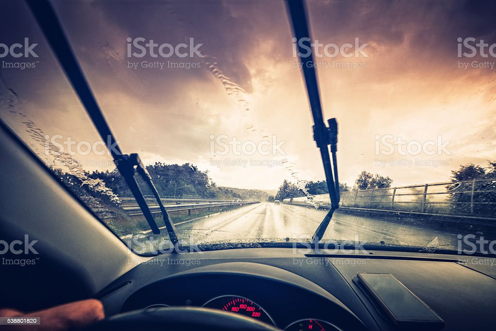 driving through a rainy highway stock photo