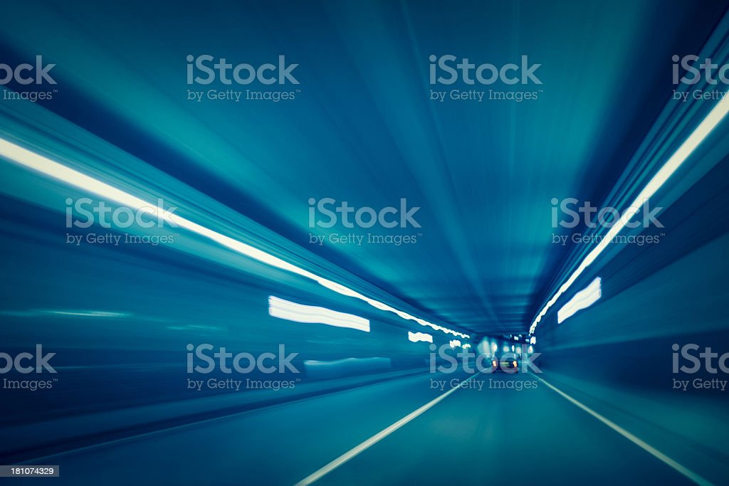 Driving through a tunnel with long exposure light trails royalty-free stock photo
