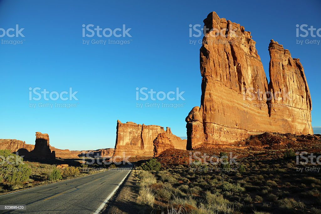 Driving through Arches NP at sunrise stock photo