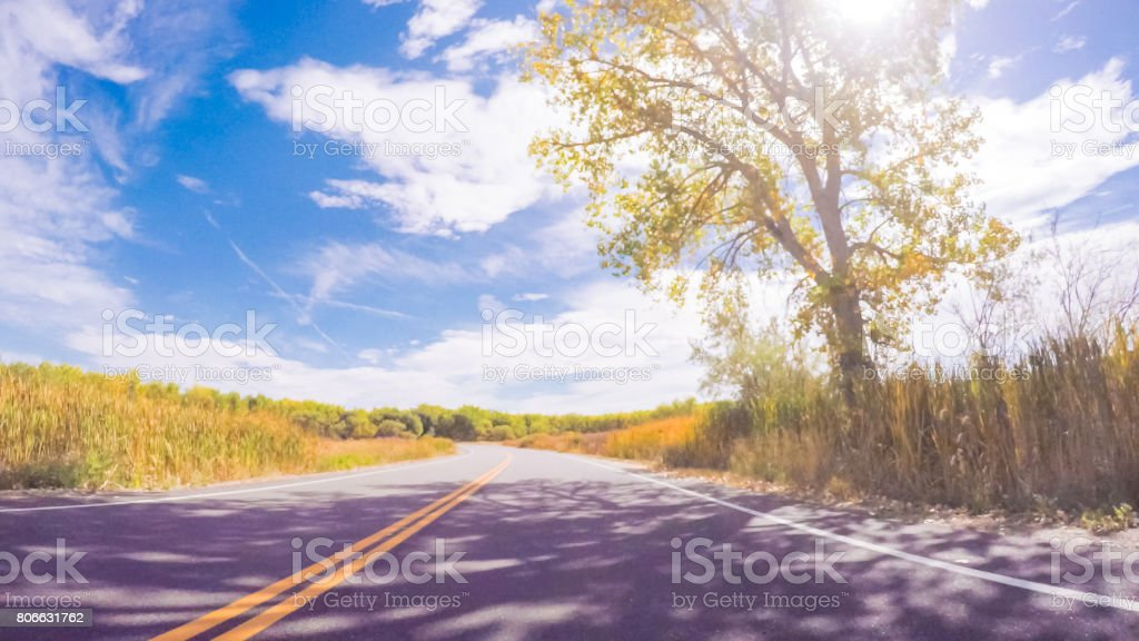Driving through Cherry Creek State Park in the Autumn stock photo