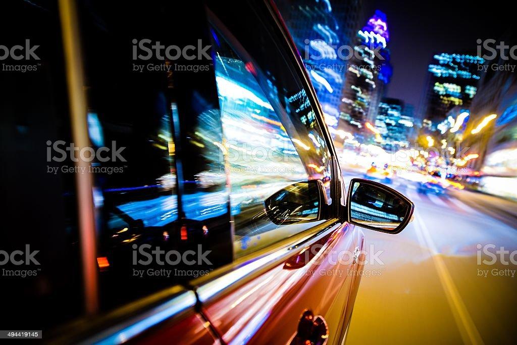 Driving Through City Lights stock photo