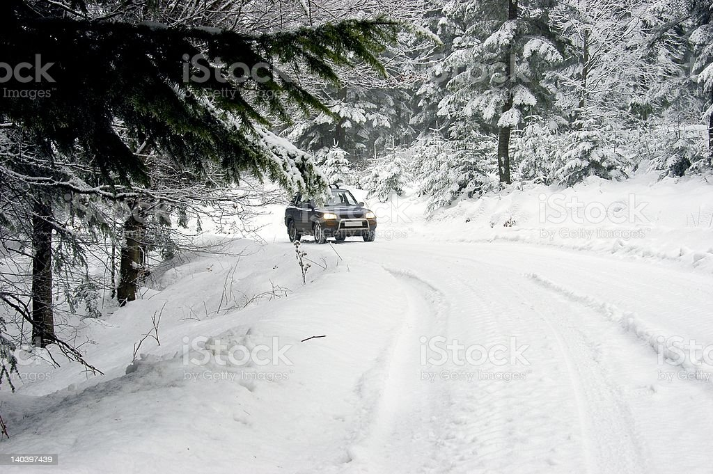 driving through the snowy road royalty-free stock photo