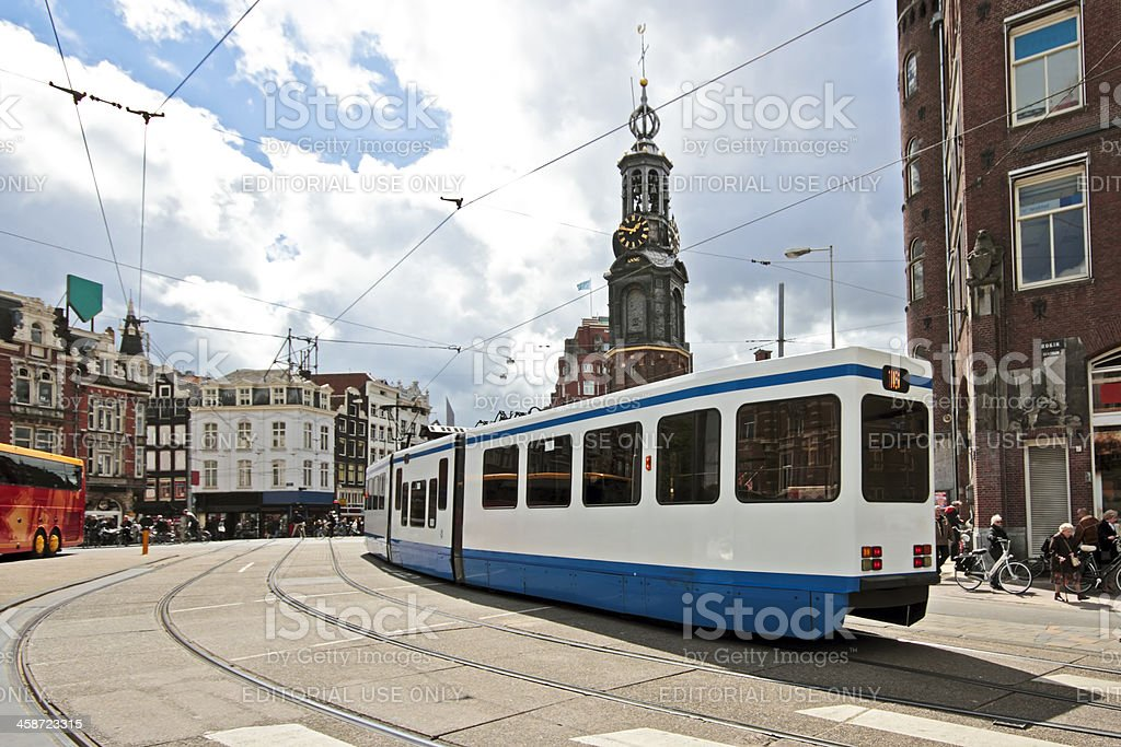 Driving tram in front of the Munt tower Amsterdam Netherl stock photo