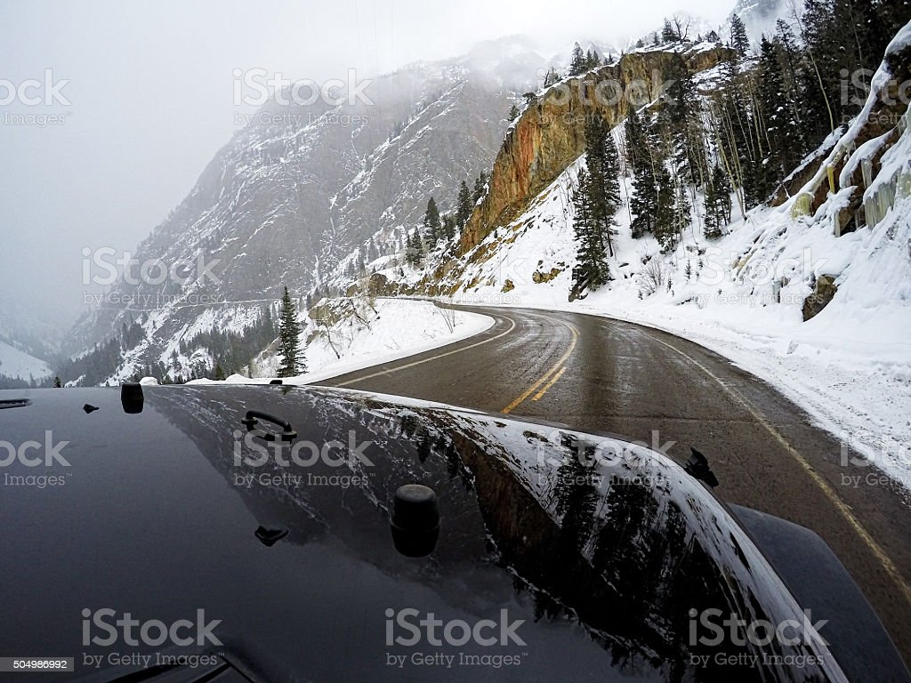 Driving up Red Mountain Pass During Scary Snowy Conditions stock photo